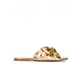 Gold flat sandals with bow detail Pura López