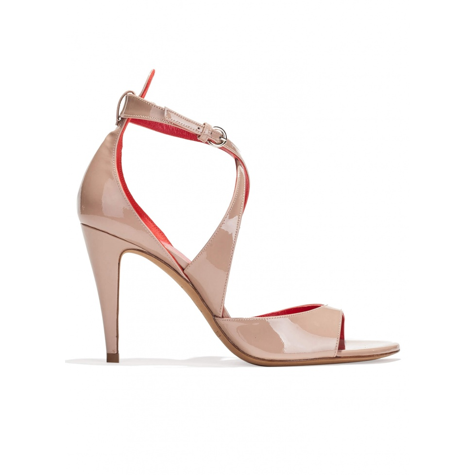 Strappy high heel sandals in nude patent leather