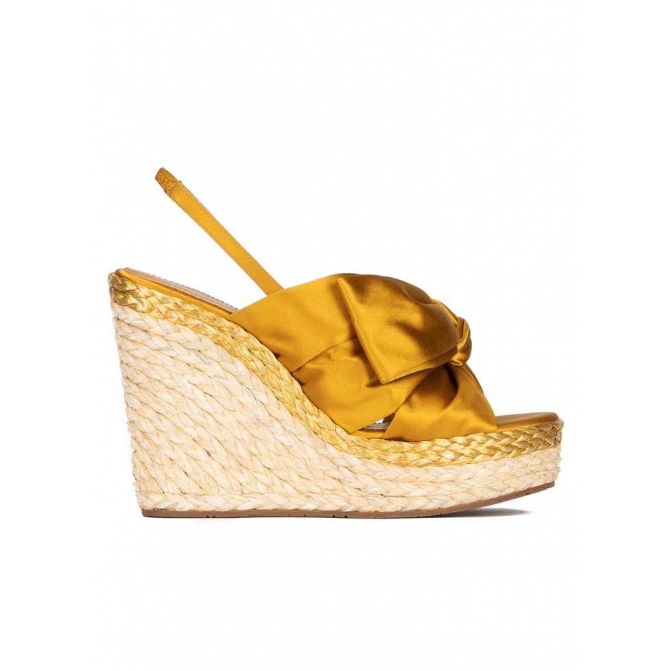 Wedge sandals in mustard yellow satin and natural raphia