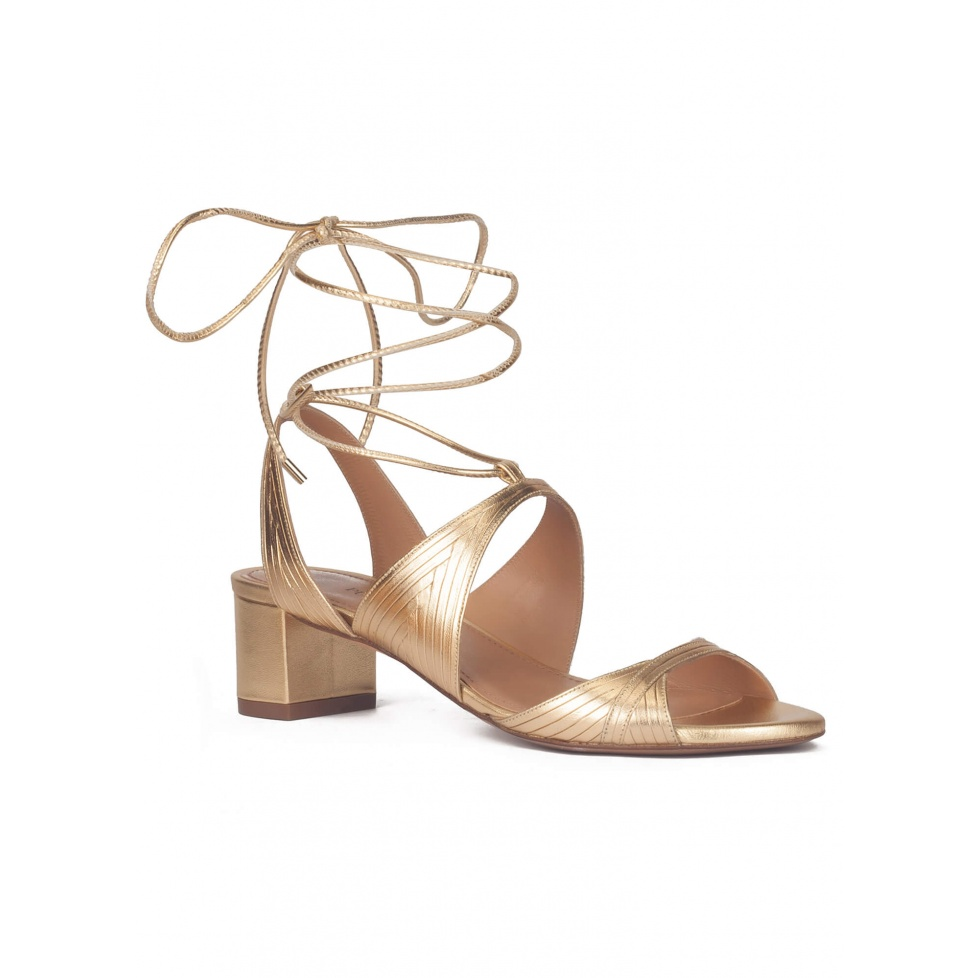 Lace-up strappy mid heeled sandals in gold metallic leather
