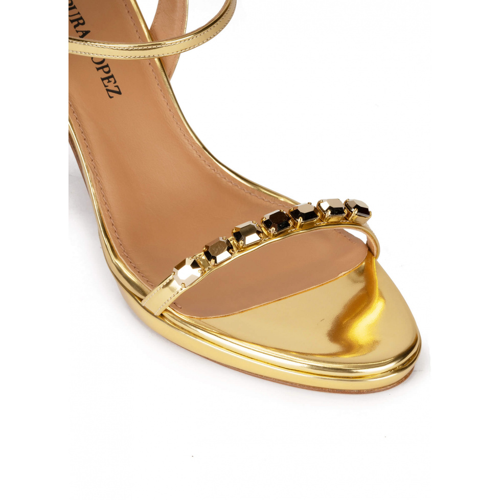 Crystal embellished platform high heel sandals in gold