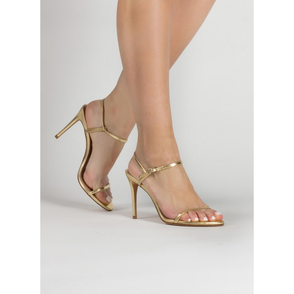 Strappy high heel sandals in gold leather