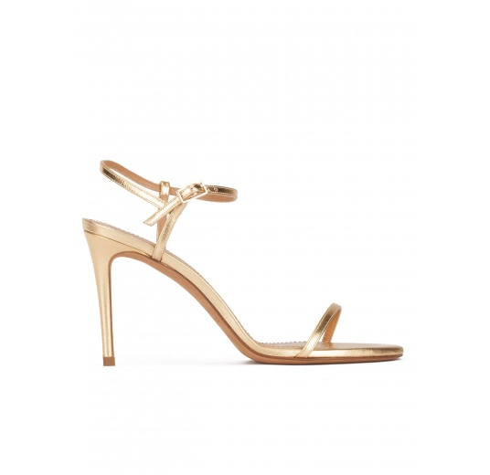 Strappy high heel sandals in gold leather Pura L�pez