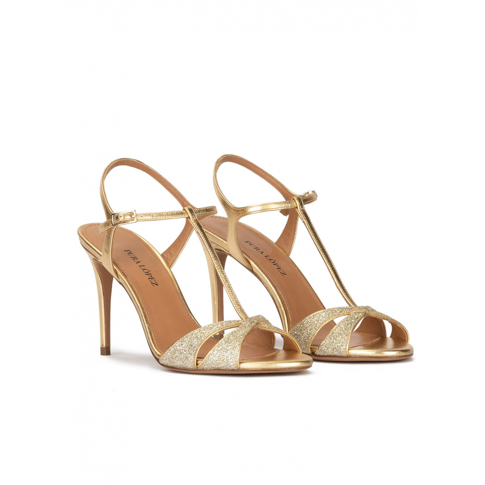 Gold high heel sandals in glitter and metallic leather