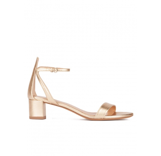 Strappy mid block heel sandals in gold metallic leather Pura L�pez