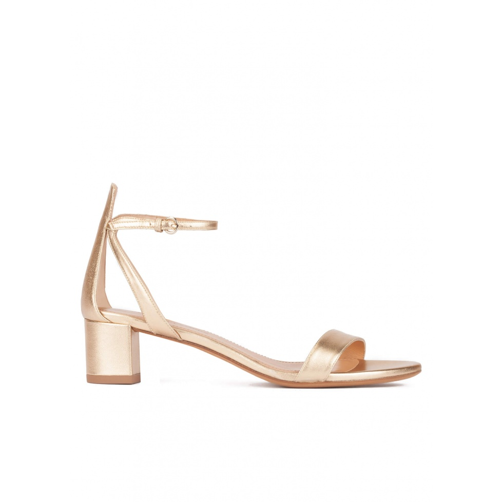 Strappy mid block heel sandals in gold metallic leather