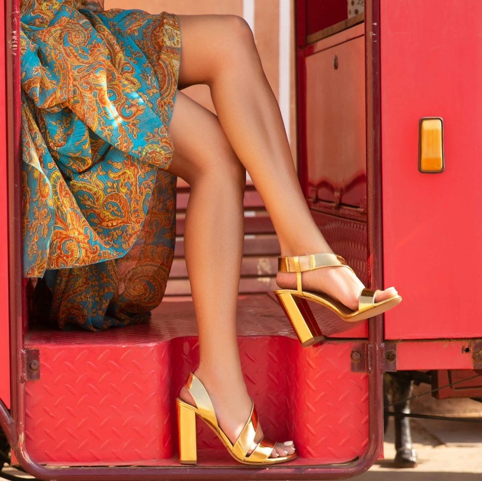 Gold strappy high block heel sandals in mirrored leather
