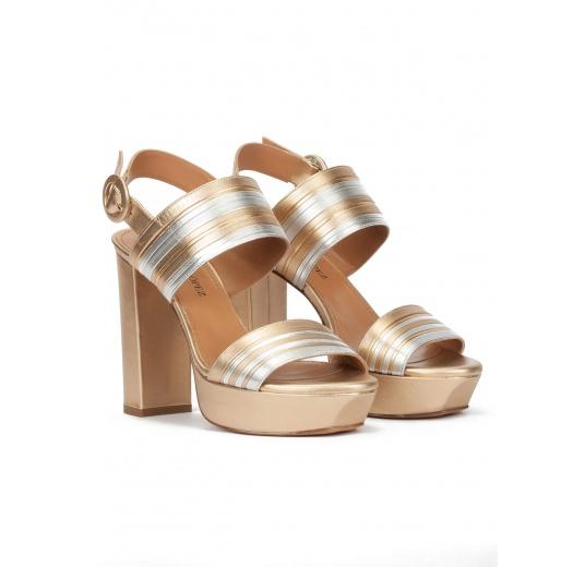 Sandalias de plataforma y tacón alto en piel oro y plata Pura L�pez