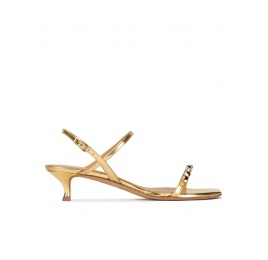 Crystal-embellished mid heel sandals in gold metallic leather Pura López