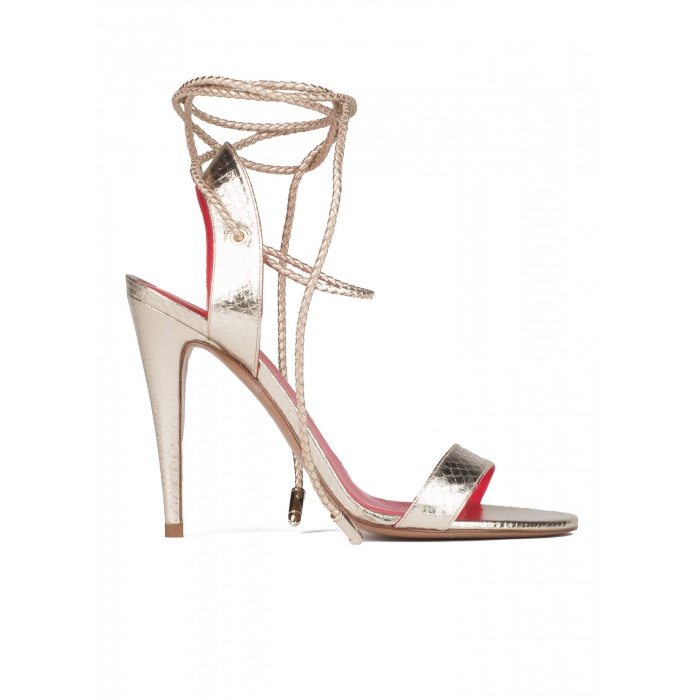 Lace-up high heel sandals in snake metallic leather