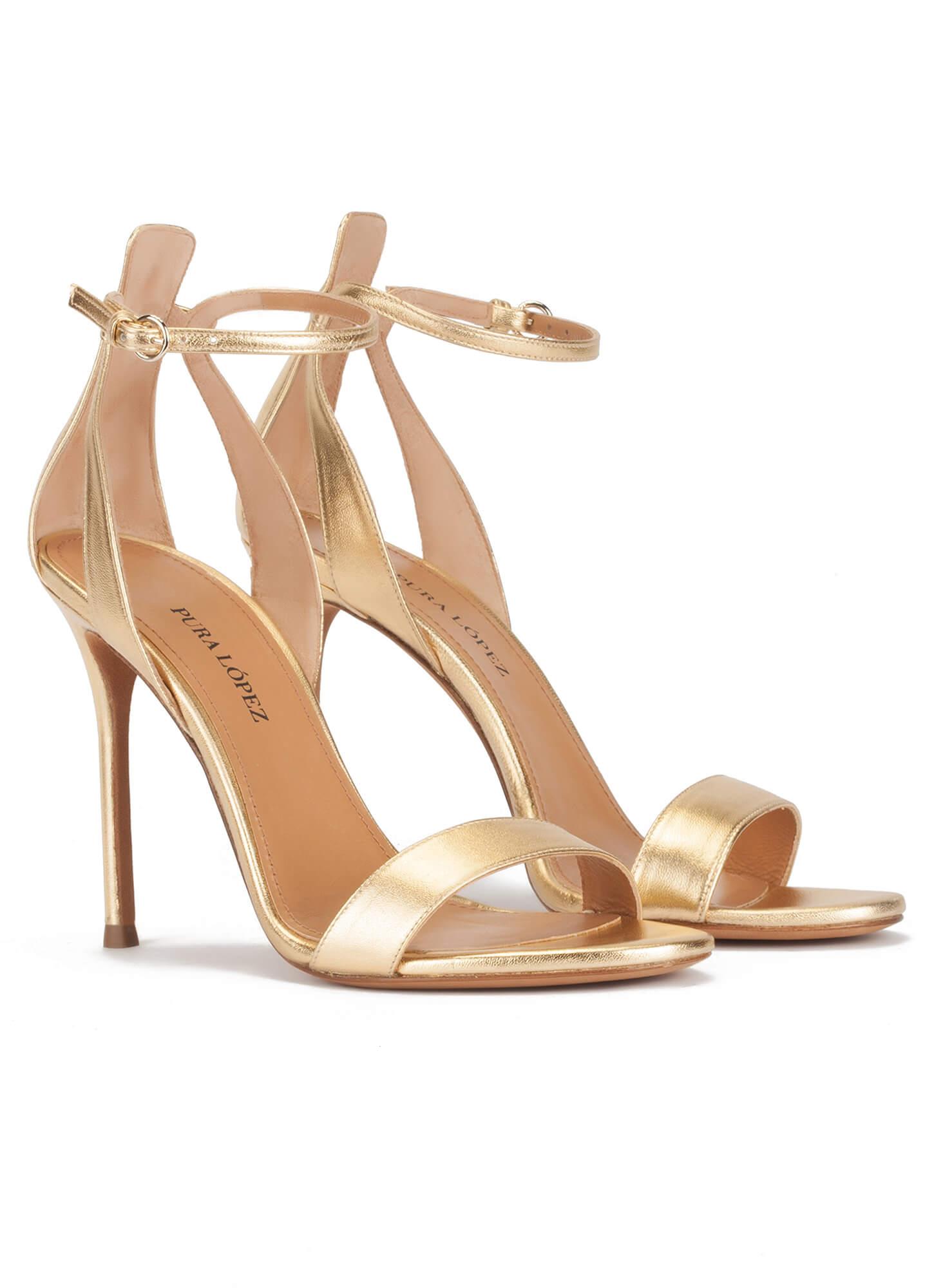 636c051b3f Ankle-strap high heeled sandals in gold metallic leather. Martina Pura López.  prev. next