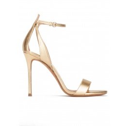 Ankle-strap high heeled sandals in gold metallic leather Pura López