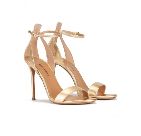 Ankle-strap high heeled sandals in gold metallic leather Pura L�pez