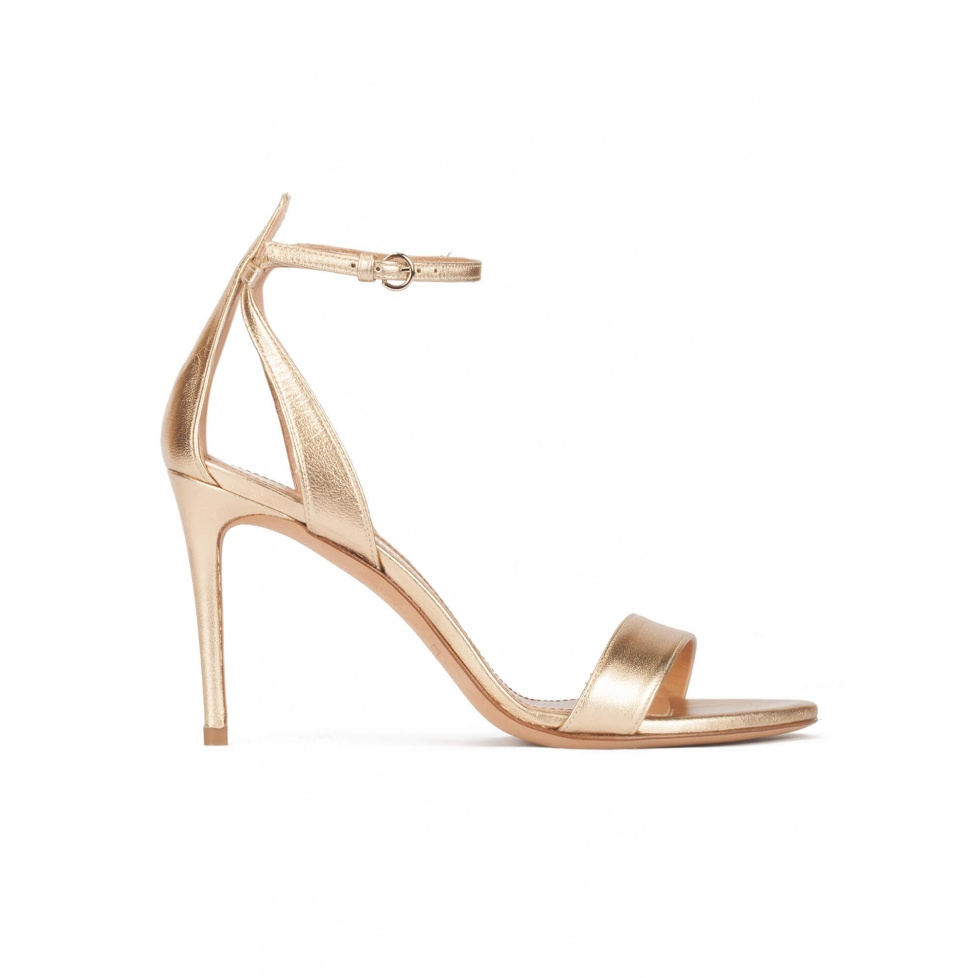 Ankle strap high-heeled sandals in gold leather