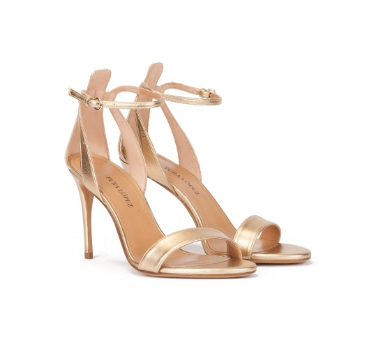 Ankle strap high-heeled sandals in gold leather Pura López
