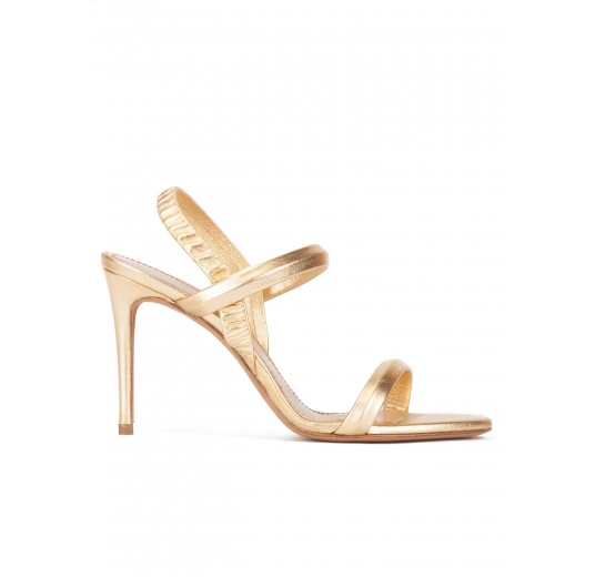 High stiletto heel sandals in gold leather Pura L�pez