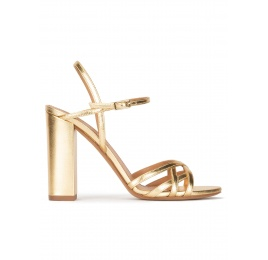 Gold high block heel sandals in metallic leather Pura López