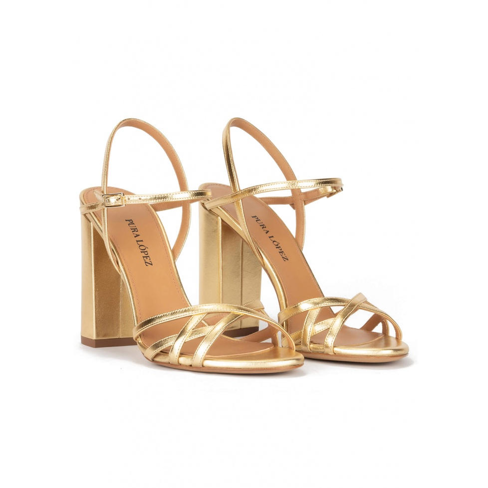 Gold high block heel sandals in metallic leather