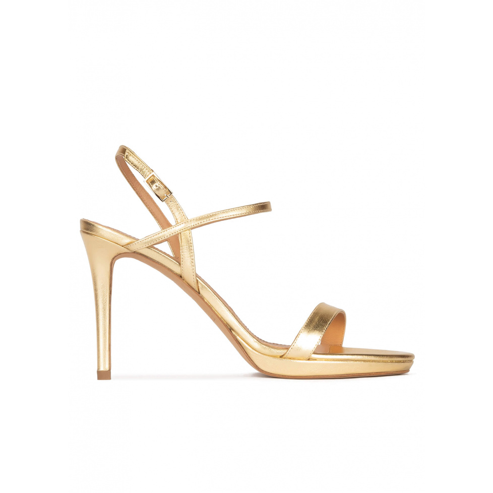 Platform high heel sandals in gold metallic leather