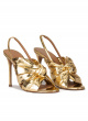 Bow detailed gold high heel sandals in metallic leather