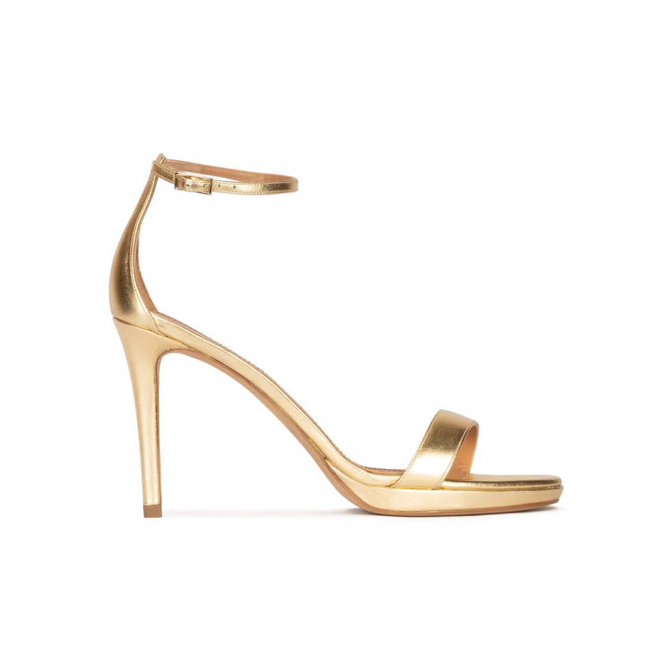 Ankle strap platform high heel sandals in gold leather