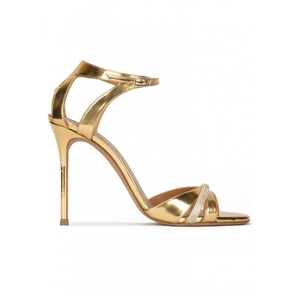 Gold high heel sandals in metallic leather