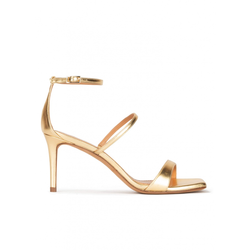 Ankle strap mid heel sandals in gold leather