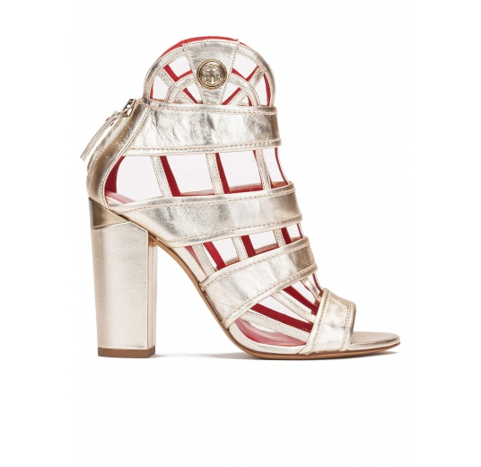 High block heel cage detailed sandals in metallic leather Pura López