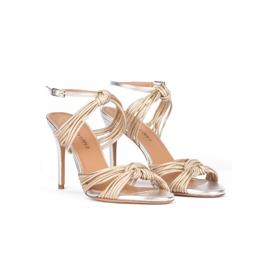 Knotted high-heeled sandals in gold metallic leather Pura L�pez