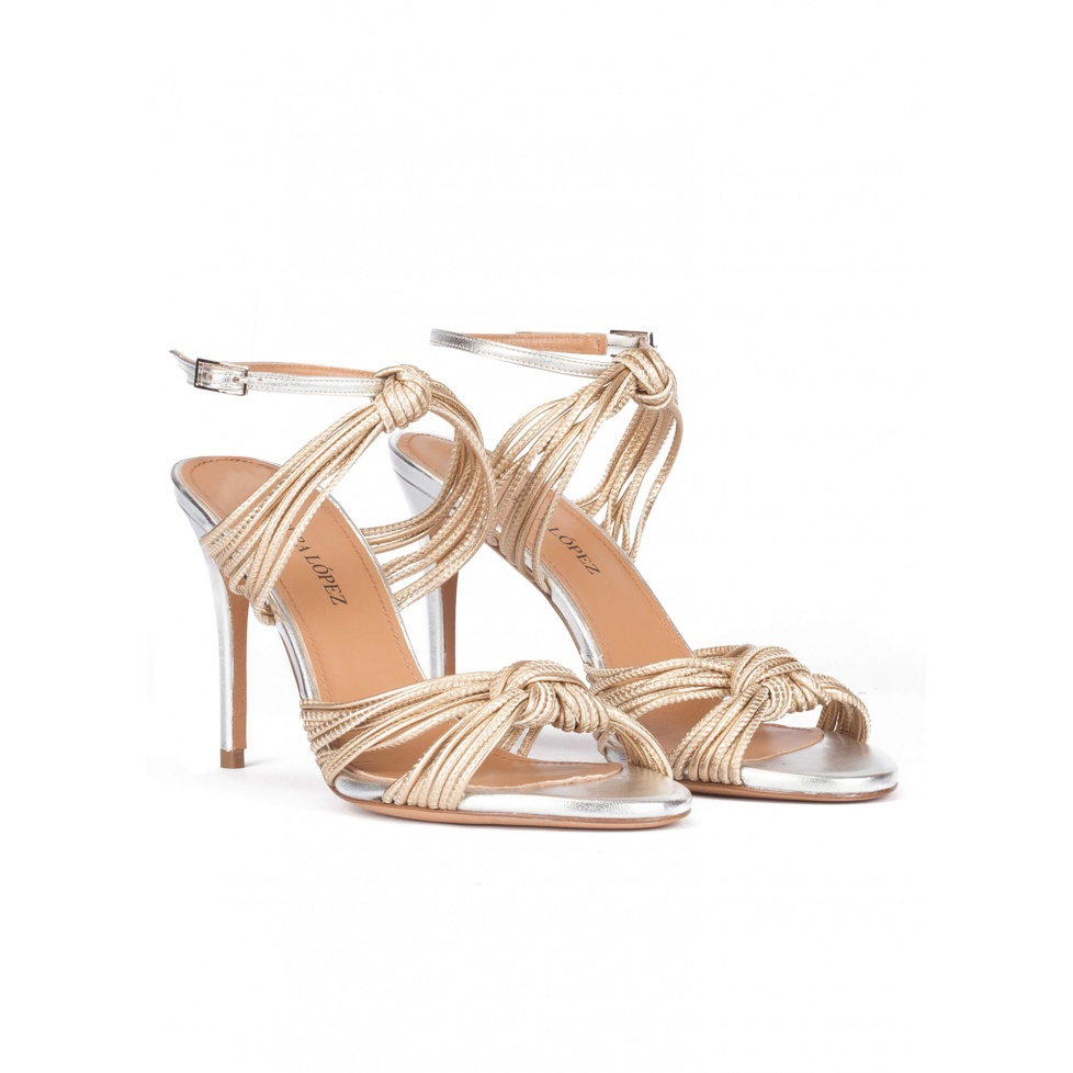 Knotted high-heeled sandals in gold metallic leather