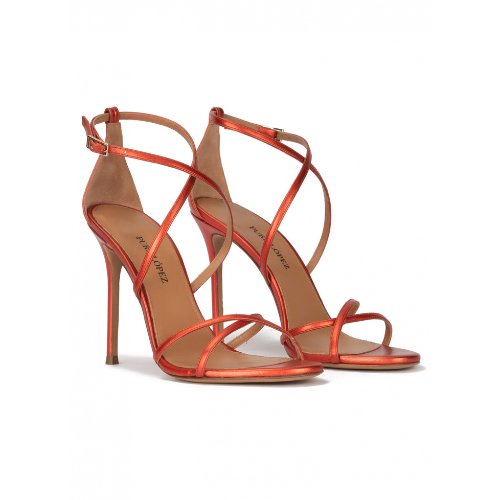 Crossed-strap high heel sandals in coral metallic leather