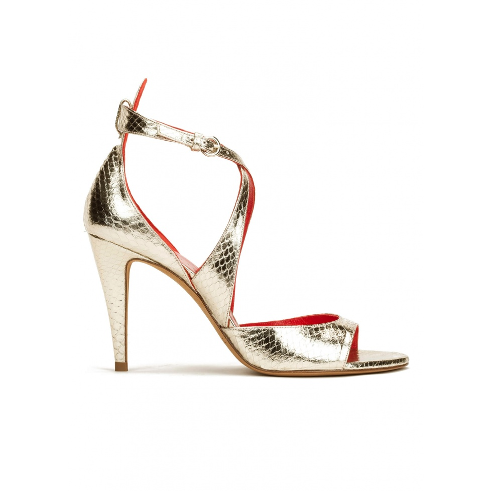 Strappy high heel sandals in platin metallic snake leather