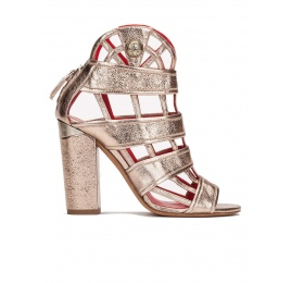 High block heel cage detailed sandals in champagne leather Pura López