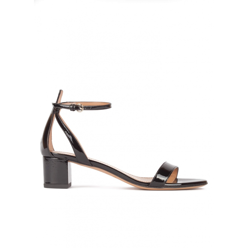 Mid block heel sandals in black patent leather with ankle strap
