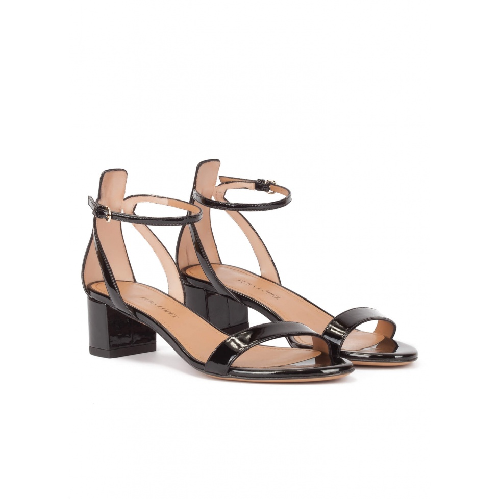 Mid block heel sandals in black patent with ankle strap
