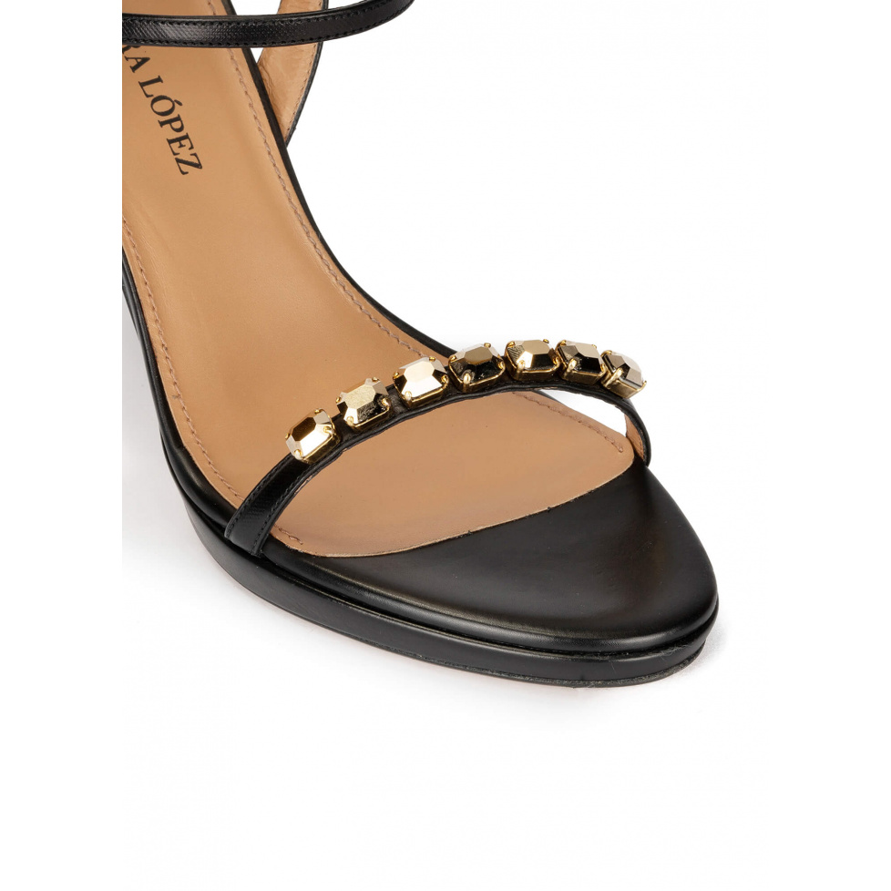 Crystal embellished platform heeled sandals in black