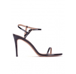 Strappy stiletto heel sandals in black patent leather Pura López