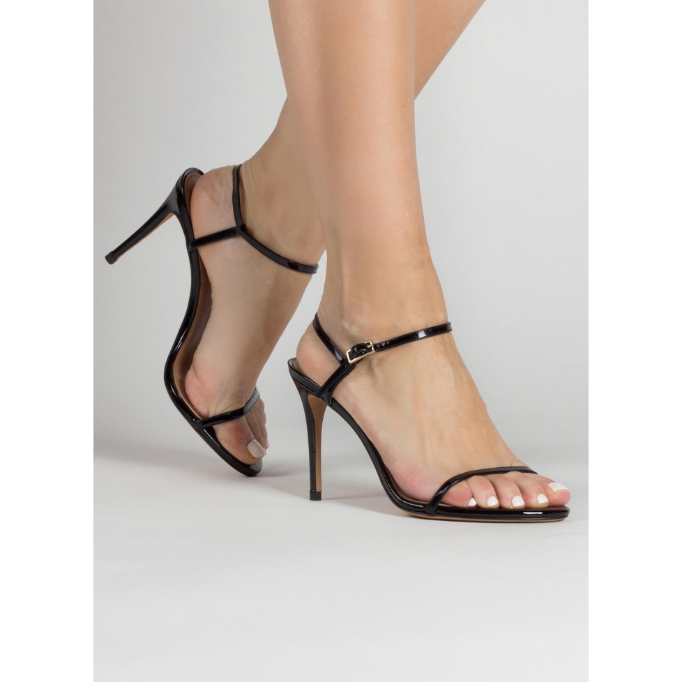Strappy stiletto heel sandals in black patent leather