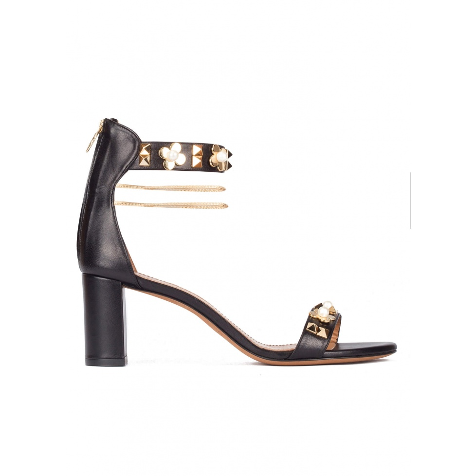 Black leather mid block heel sandals with ankle strap and flower trims