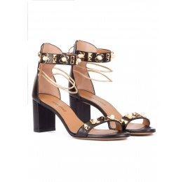 Black leather mid block heel sandals with ankle strap and flower trims Pura López