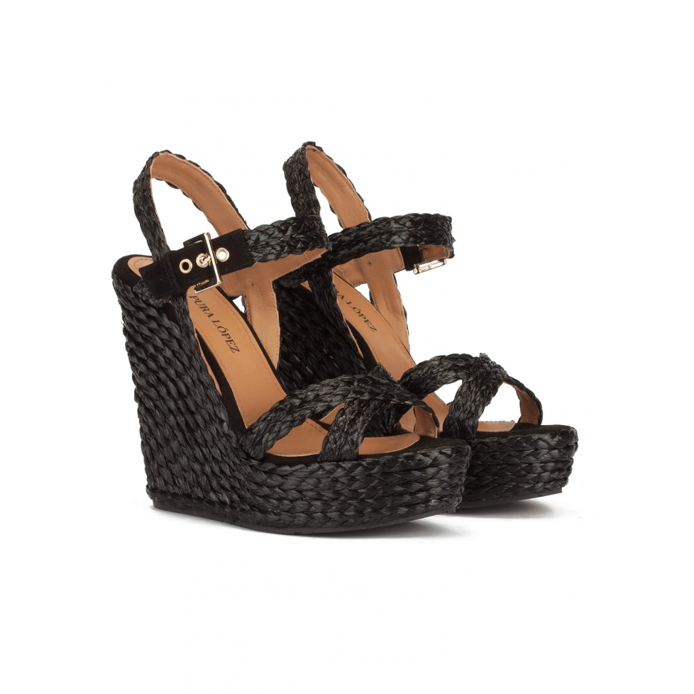 High wedge sandals in black raffia with buckle fastening