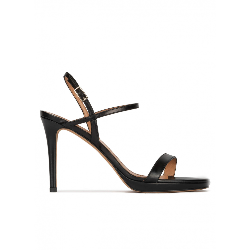 Platform heeled sandals in black leather