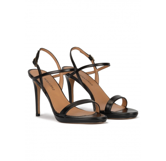 Platform heeled sandals in black leather Pura López
