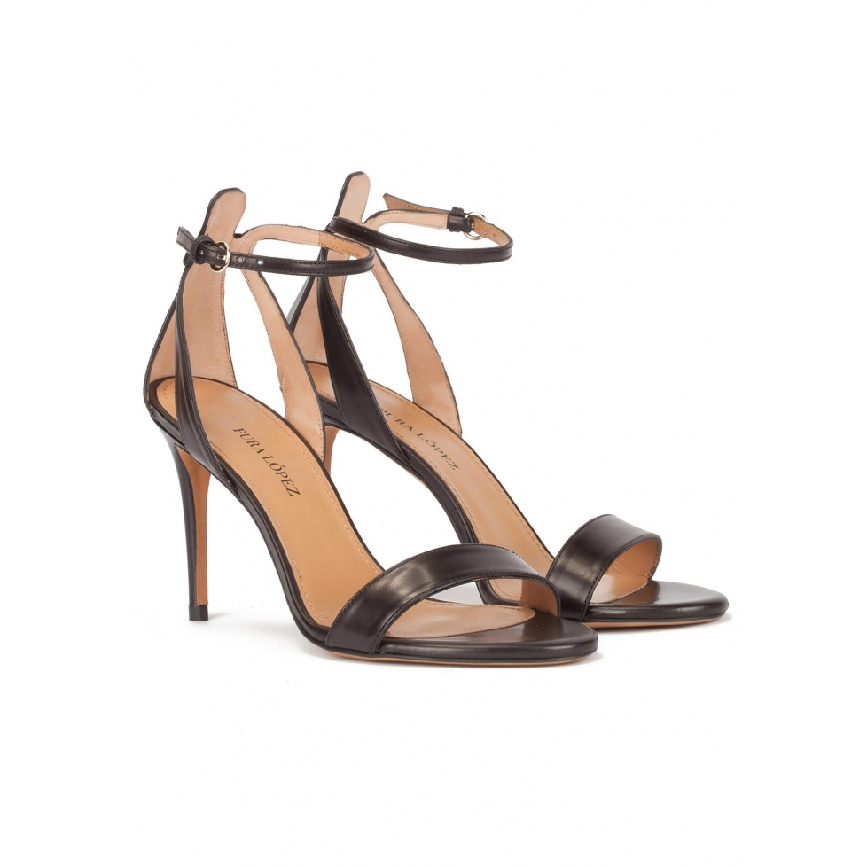 Minimalist ankle strap high heel sandals in black leather