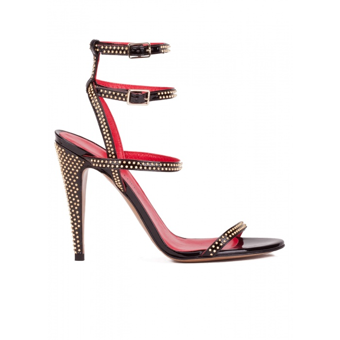 Studded high heel sandals in black patent leather