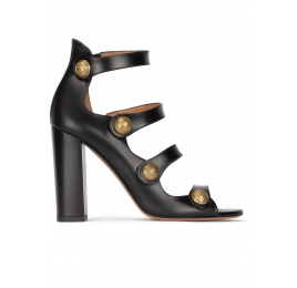 High block heel sandals in black leather with golden buttons Pura López