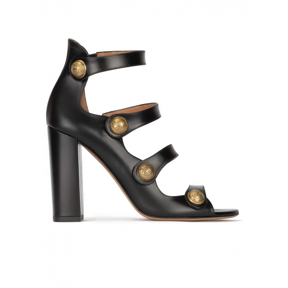 High block heel sandals in black leather with golden buttons