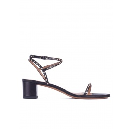 Studded mid block heel sandals in black leather Pura López