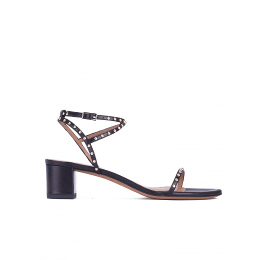 Studded mid block heel sandals in black leather Pura L�pez