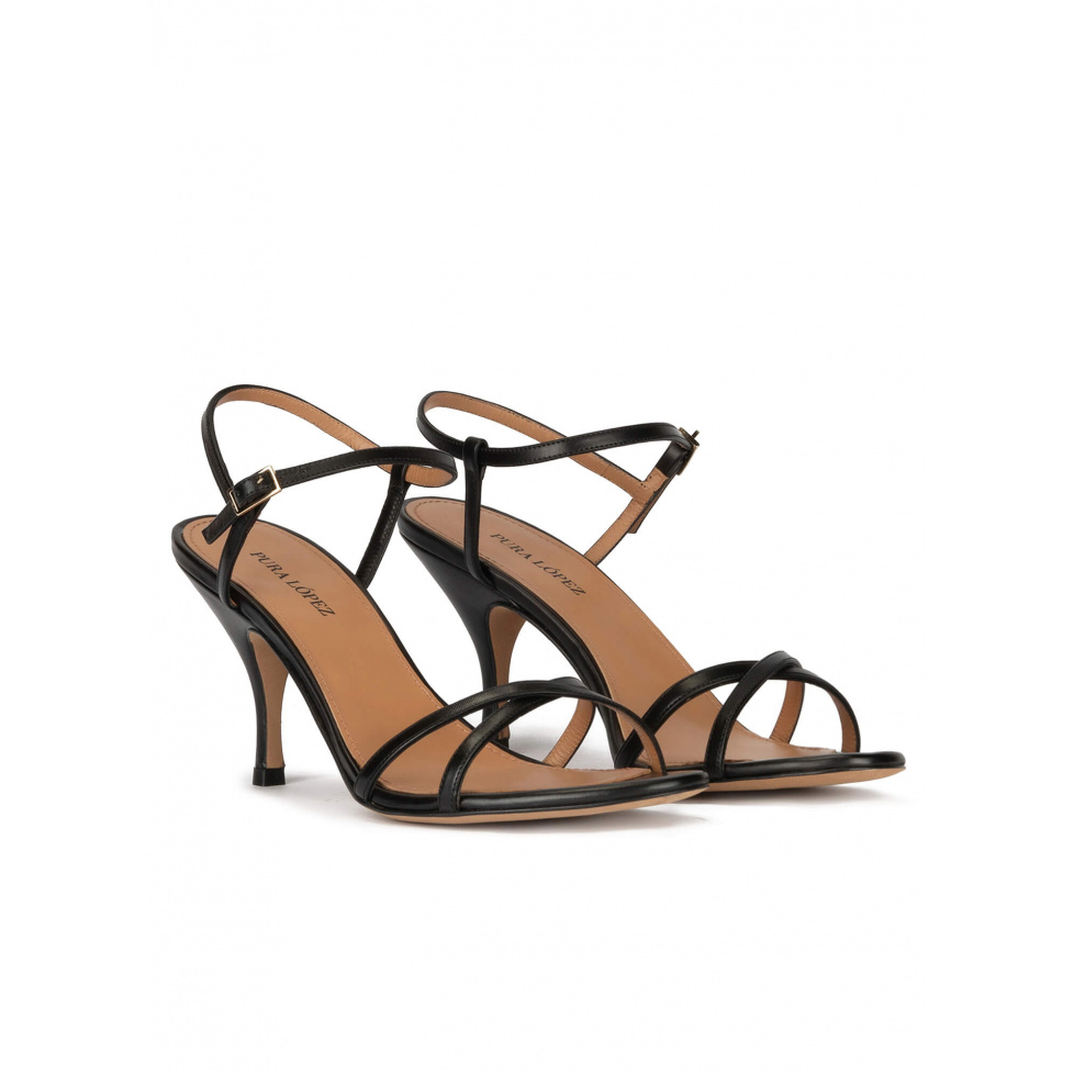 Strappy mid curved heel sandals in black leather